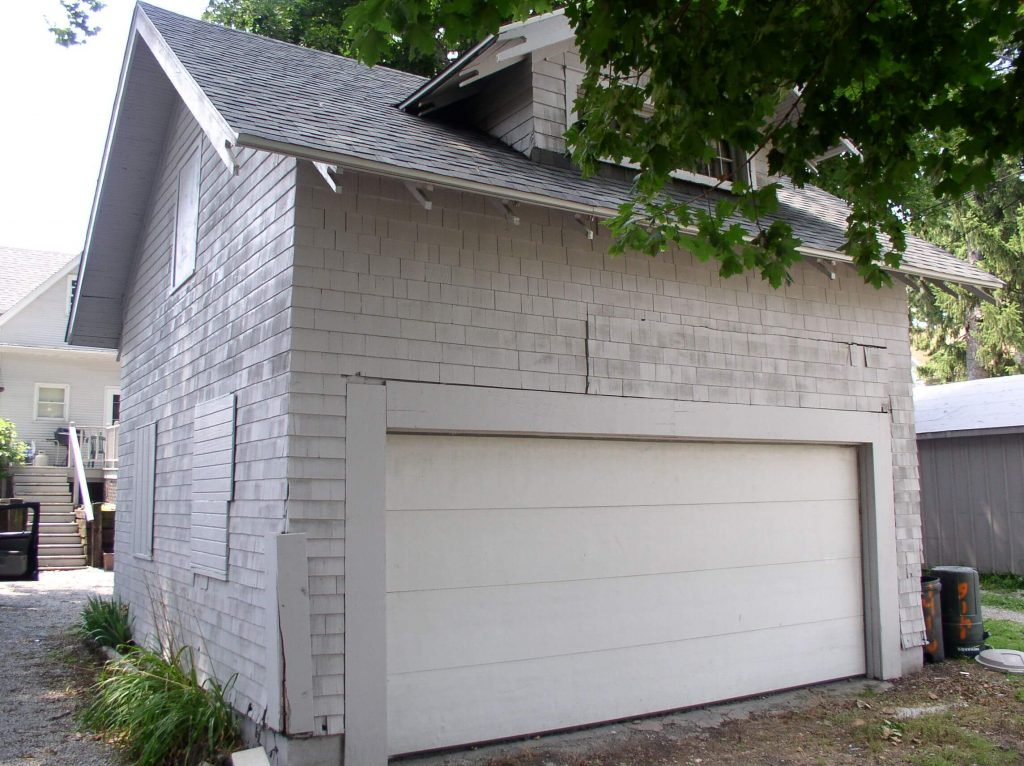 The 2 car lofted garage was recently sided and has electric.